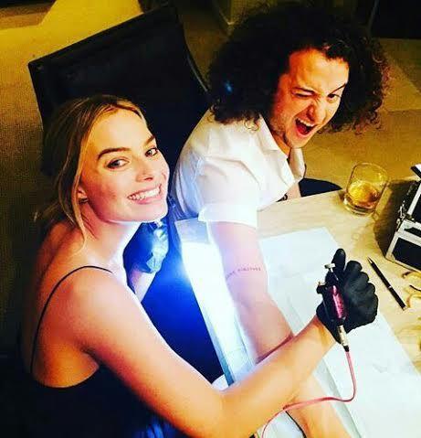 Margot Robbie Giving A Tattoo 2016
