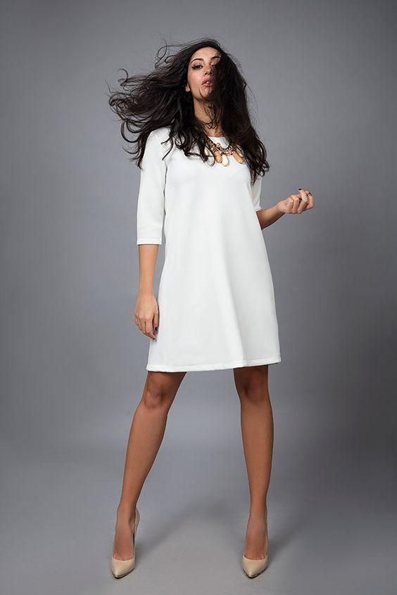 white mini dress... find it online at www.disu.gr