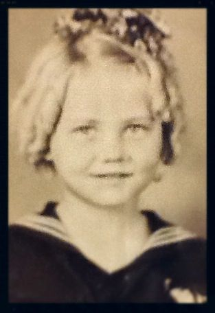 My mother about 7 years old. She reminds me of Shirley Temple.  She was born during the early years of the Great Depression and she and her family went through some very difficult times.