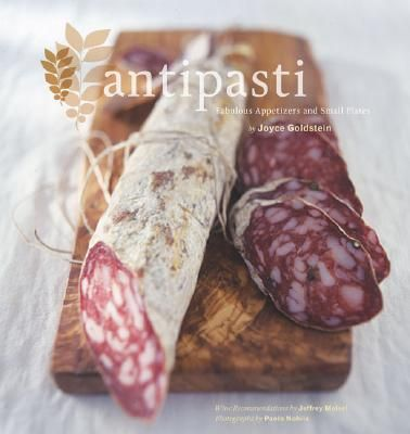 """""""Antipasti: Fabulous Appetizers and Small Plates"""" by Joyce Goldstein. Offering a range of recipes from the complex to the """"shop & serve"""", this tasty little book will have you at the market for soft cheeses and crusty artisan breads in no time!"""
