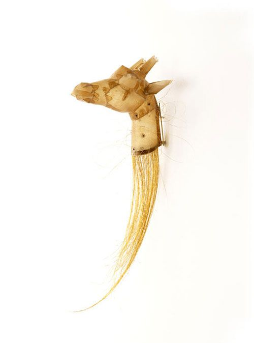 Brooch by Eun Mi Chun: Giraffe 2011 23 x 8 x 9 cm. Human hair, gold leaf, small intestine of cow, seeds, silver:
