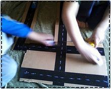 Make road from black tape, cut up boxes and a white crayon!