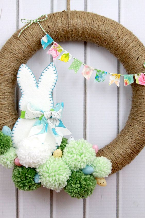 Easter Pom Pom Wreath Welcome the Easter bunny into your home with this adorable fluffy pom pom-covered spring wreath. #easter #easterideas #easterrecipes #easterdesserts #easterdrinks #easterdecor