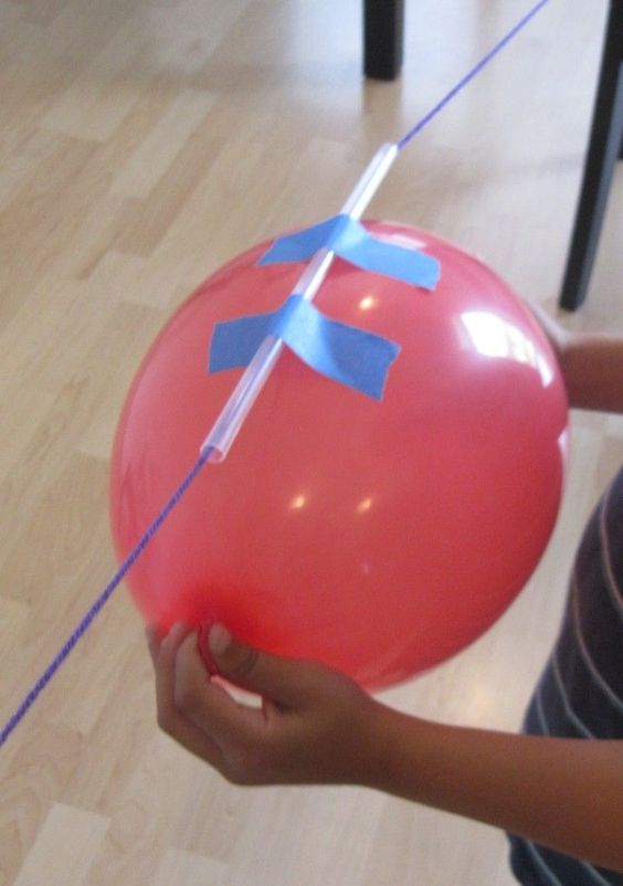 Create a balloon rocket that demonstrates how force works.