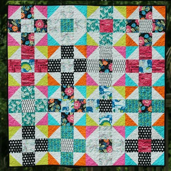 The Mod Nine Patch quilt pattern is a super easy to piece simple twist on a nine patch quilt block, adding half-square triangles to the corn...