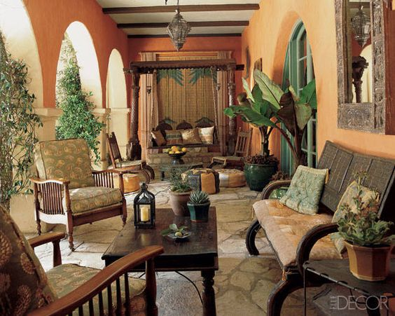 In her Beverly Hills home, which was decorated by Madeline Stuart, Hollywood producer Lisa Henson flanks the doors of her terrace with banana trees planted in gleaming green-glazed pots.