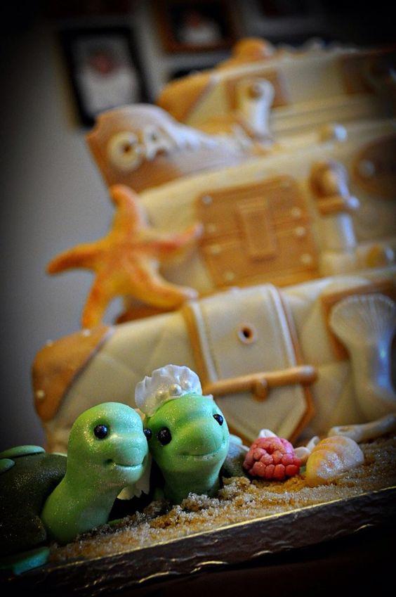 Wedding beach cake with green love turtles.