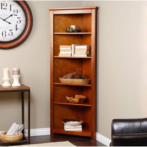 Finley Home Redford Corner Bookcase - Oak - Finally, the place where your walls come together can be as storage-ready as the rest of your room. The Finley Home Redford Corner Bookcase in Oak...