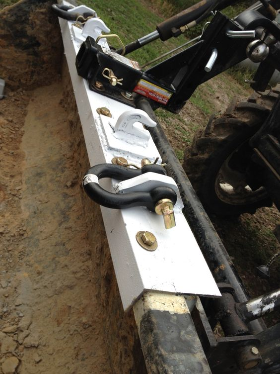 Close up of homemade tractor bucket hitch and chain lift unit