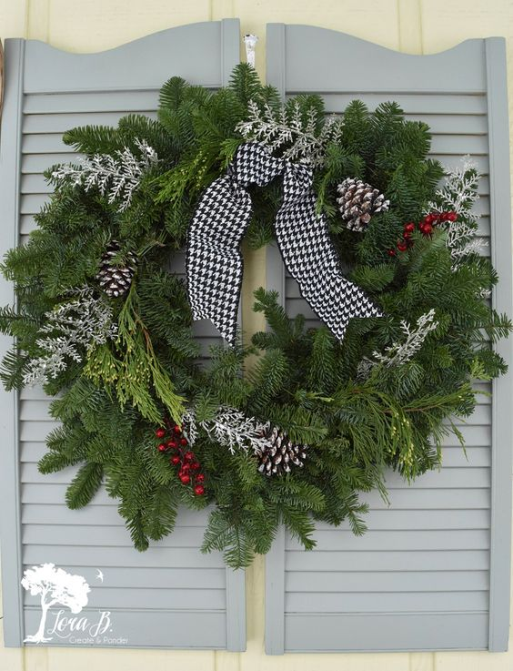 A porch overhang is a great excuse for some beautiful, wintry styling!