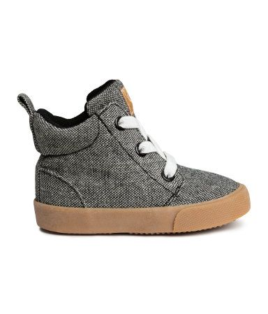 Black melange. High tops in thick, woven cotton fabric with a lightly padded ankle, elasticized lacing, and loop at back. Mesh lining, mesh insoles, and