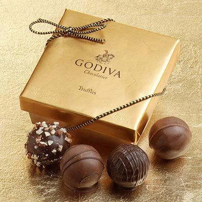 """Godiva Chocolatier is a manufacturer of premium chocolates and related products. Godiva, founded in Belgium in 1926, was purchased by Turkish Yıldız Holding, owner of the Ülker Group, on November 20, 2007.In addition to chocolates, Godiva also sells truffles, coffee, cocoa, biscuits, dipped fruits and sweets, chocolate liqueur, shakes,wedding and party favors and other items arranged in gift baskets.Godiva's signature package is the Gold Ballotin (French for """"small, elegant box of…"""