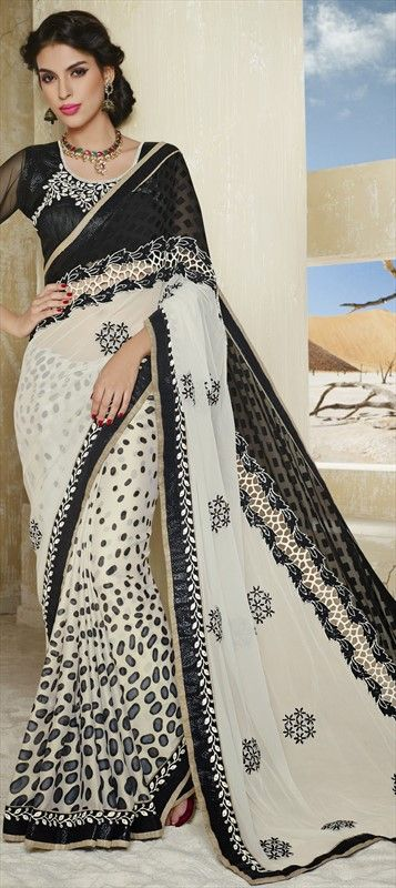 156208: MONOCHROME - this happens when animal prints and florals get together. #Prints #Saree #Partywear #IndianFashion: