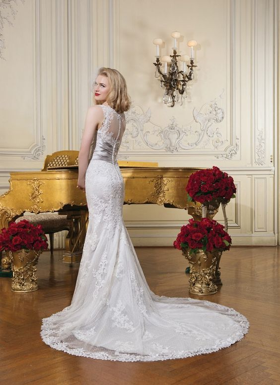 Sheer venice lace sabrina neckline accents this sweetheart neckline with pleated regal satin cummerbund at waist, textured lace trumpet skirt and chapel length train. Buttons over back zipper. https://www.justinalexanderbridal.com/wedding_dresses/8596: