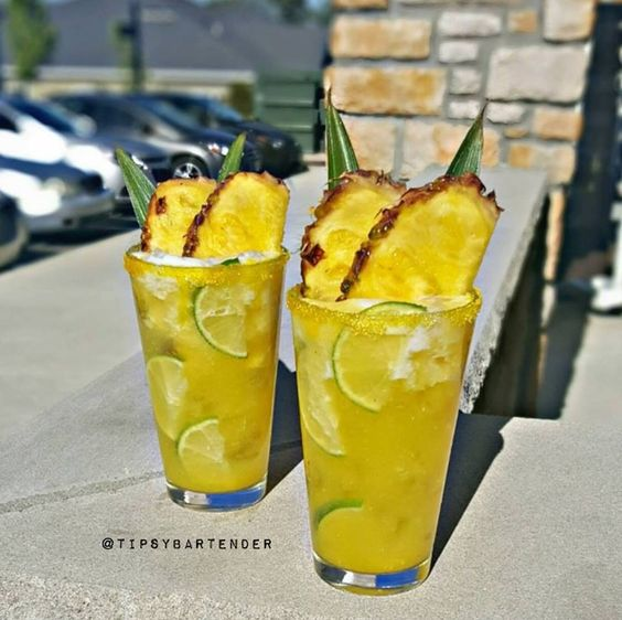 Summer Pineapple Margarita - For more delicious recipes and drinks, visit us here: www.tipsybartender.com