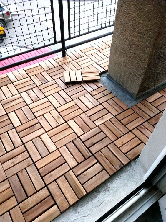 Wooden floor tiling for an apartment balcony. Great idea to customize a rental!: