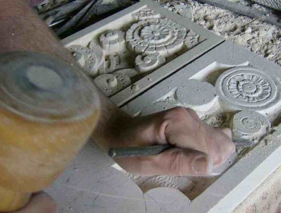 Arto deco panels being carved