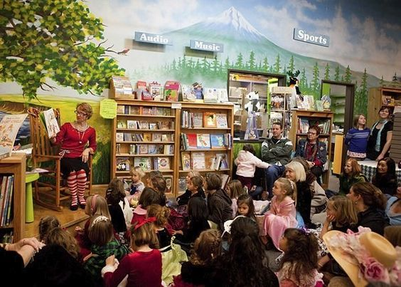 14 of the Absolute Best US Kids Bookstores  I love how this woman's outfit declares that she loves her job!