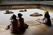 Tourists at Zen rock garden at Ryoanji Temple.