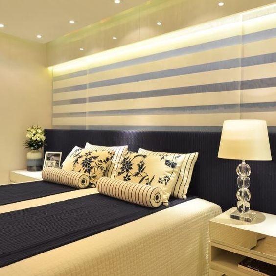 Para quem adora azul com eu um quarto lindo e inspirador com destaque para o mix de estampas e listras.