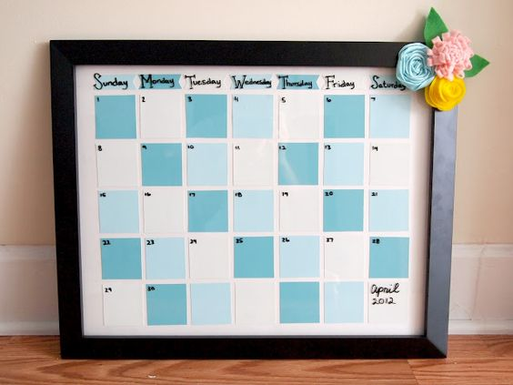 reusable calendar with paint chips and dry erase markers :)