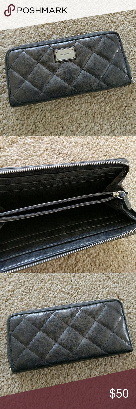 Michael Kors Michael Kors gunmetal quilted wallet in used but still good condition. Some wear on the metal tag (see picture) Michael Kors Bags Wallets