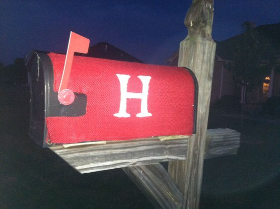 Red burlap mailbox cover. I used an old mailbox cover with the letter H on it. First I traced that H and the shape, then spray painted the old cover red. I actually put the burlap on it while the paint was still wet so it stuck good. Then painted the H sprayed it with modpodge acrylic spray and placed back onto the mailbox!