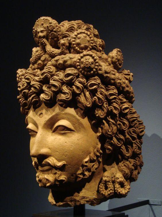 stucco head from Gandhara maybe a bohdisattva