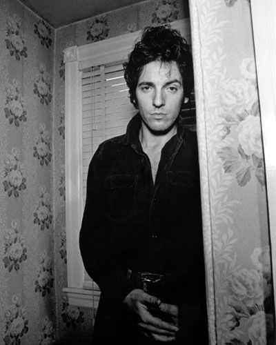"""Bruce Springsteen in front of the """"cabbage roses' wallpaper, Haddonfield, New Jersey, 1978."""