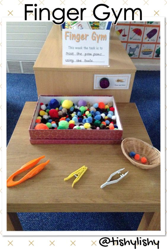 Finger Gym challenge area - transporting pom poms with 3 different tools. …