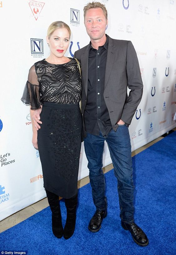 Love is in the air: The actress, who posed with her husband musician Martyn LeNoble, sport...