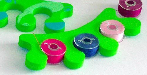 Keep your filled bobbins together by storing them in a foam toe separator, the kind used for pedicures. GEnius!!