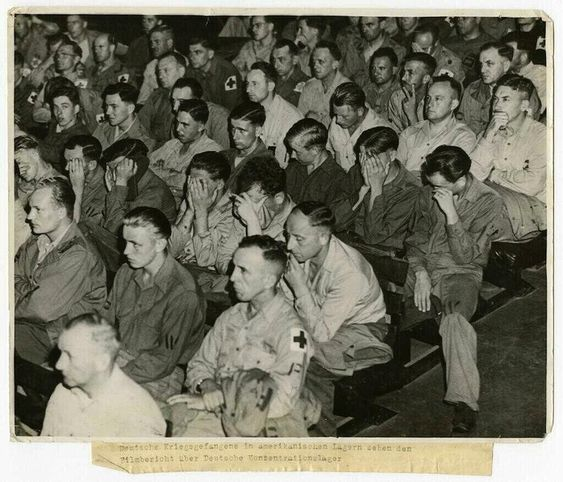 German soldiers, in an American prison, forced to watch a film of German concentration camp.