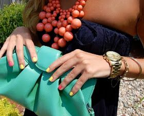 Love the clutch, necklace and nails