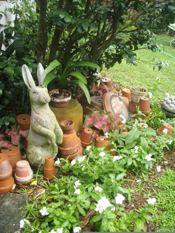 A little Beatrix Potter décor is a nice touch for your English cottage garden. The messy, slightly wild appearance of this landscaping style gives you ample opportunity to incorporate animal statuary. Just stick with rural country species like hedgehogs and rabbits