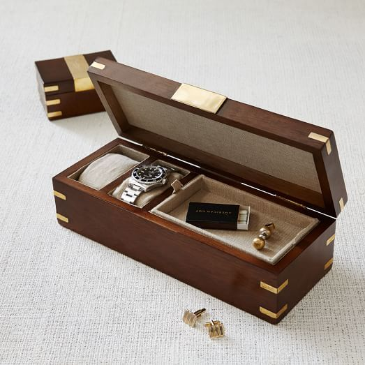 Made of sheesham wood and accented with real brass, this watch box is a stylish home for his favorite timepieces and small accessories.