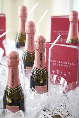 mini champagne bottles. favours to each guest at the wedding