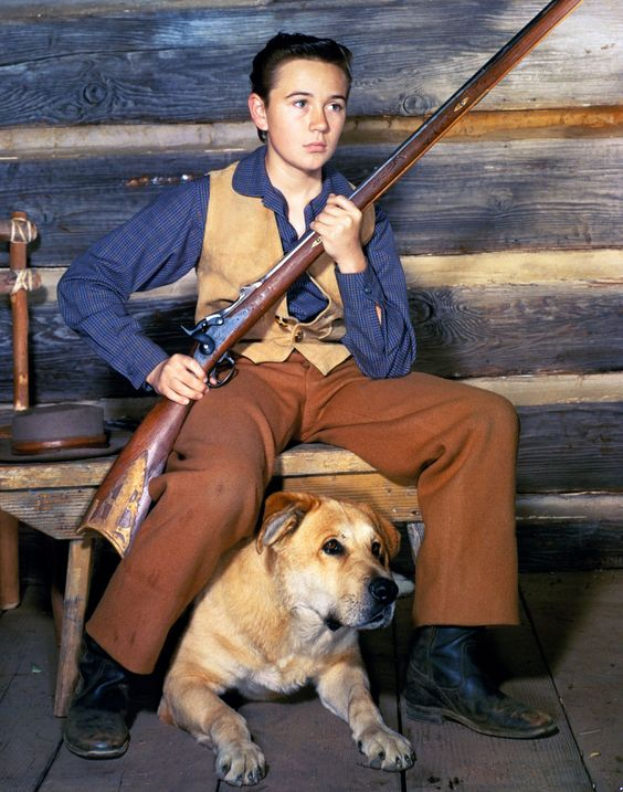 """Old Yeller"" (1957) .. The rush of sadness you felt when Travis was forced to shoot Old Yeller. I cried and cried."