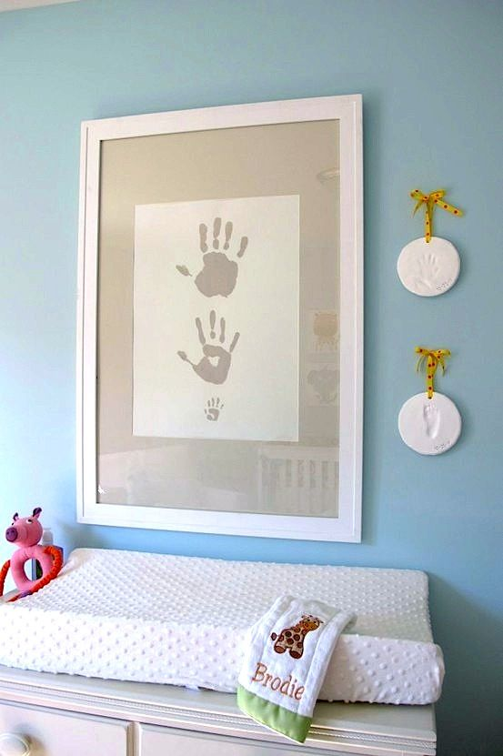 Handprints of dad, mom, and baby alongside cast hand and footprints.