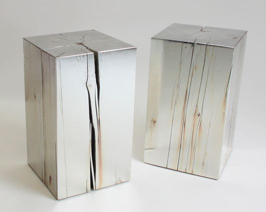 The 47 table by Council Design. The San Francisco firm renders a chunk of aged, reclaimed Douglas fir into a sculptural object by covering it in silver. The name 47 refers to the atomic weight of the precious metal. A protective clear coat protects against tarnish.