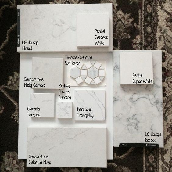 Caesarstone Calacatta Nuvo Price: Quartz Options Comparison Sitting On A Glossy White Tile. LG Viatera Rococo LG Viatera Minuet