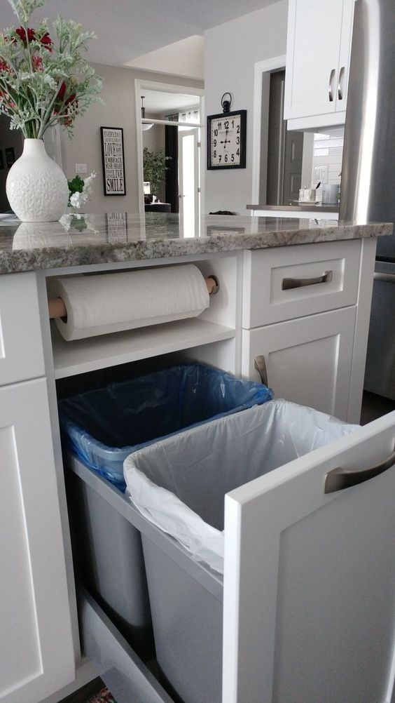Kitchen Remodeling Plan Kitchen storage idea. Garbage, recycling, and paper towels neatly tucked away.