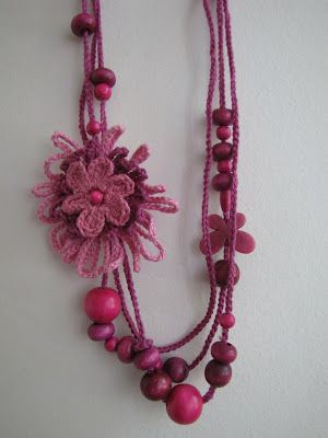 crocheted necklace with flower that looks like you could use a flower loom to make:
