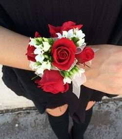 Phoenix Florist – Cactus Flower Florists, AZ – Sweetheart Prom Corsage with five red sweetheart roses and white kalanchoe http://www.cactusflower.com/ProductDetail-15131-Local+Delivery-Prom+Corsages.html: