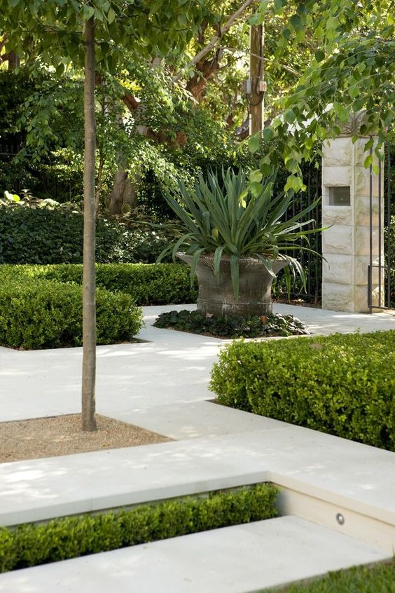 Nice combination:  greenery to break up the hard landscaping, hard landscaping to make the garden easier to maintain
