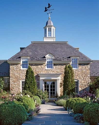 The fieldstone house's form, a half octagon, reflects Virginia's Neoclassical architectural tradition.