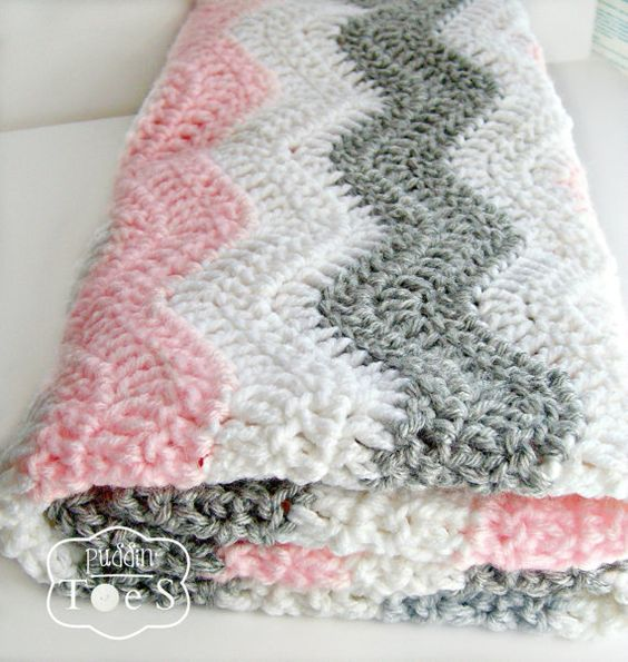 This gray and pink chevron baby blanket is the perfect complement for a baby girls pink and gray nursery! Your little princess will be warm and cozy