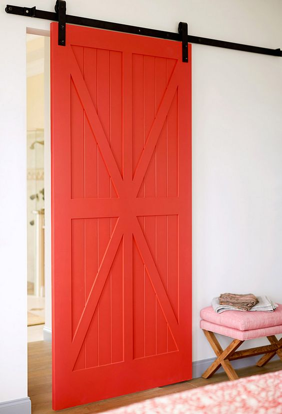 Barn door painted a lively coral-red hue