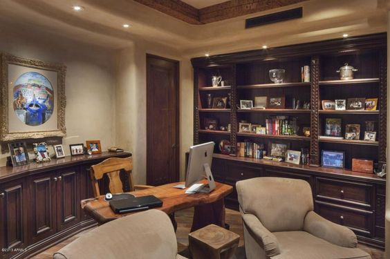 Photos on shelves for office -- most books in shelves in one room.