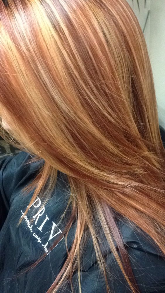 Copper red hair color with golden blonde highlights